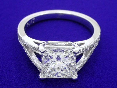 Princess cut diamond ring with pave-set diamonds on split-shank basket-style mounting