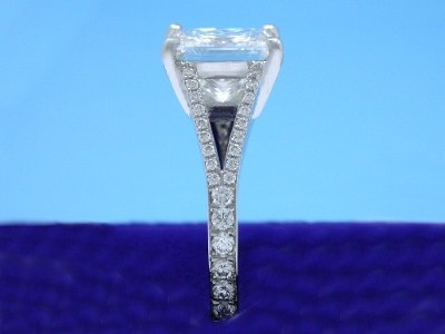 Princess cut diamond ring with platinum split-shank basket-style mounting with pave-set round diamonds on the shank