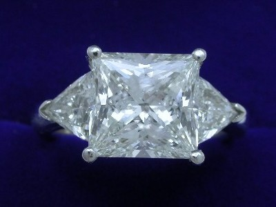 Princess Cut Diamond Ring: 3.47 carat with 1.05 tcw Trillion Cut Diamonds
