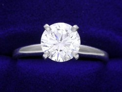 1.26 carat Round Brilliant Cut diamond with F color and SI1 clarity in a 4 prong ring