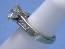 14 karat white gold mounting has six princess cut diamonds