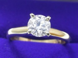 0.70 carat Round Brilliant diamond graded H color, SI1 clarity in 14-karat yellow-gold four-prong Solitaire style mounting