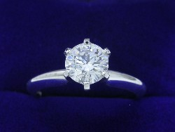 0.79 carat Round Brilliant diamond graded F color, SI1 clarity in four-prong Solitaire style mounting