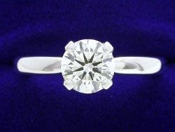 0.90 carat Round Brilliant cut diamond graded I color and SI1 clarity set in a 14-karat white-gold mounting with four-prong Solstice-style head and Bombe-style shank