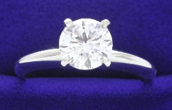 1.02 carat Round Brilliant Diamond graded H color, SI1 clarity in four-prong Solitaire style mounting