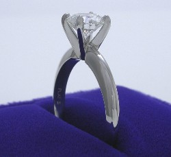 platinum four-prong solitaire style mounting