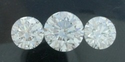 Three loose Round Brilliant G color, VS2 clarity diamonds with 1.14 carat center and 1.23 carat side stones.