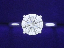 1.20 carat Round Brilliant cut diamond graded I color and VS2 clarity set in a 14-karat white-gold cathedral-style mounting.