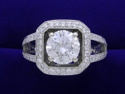 1.78 carat Round Brilliant cut diamond graded H color and VVS2 clarity set in a custom platinum and pave diamond mounting.