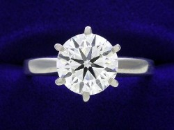 2.01 carat Round Brilliant Cut diamond graded G color and SI1 clarity in a six prong mounting