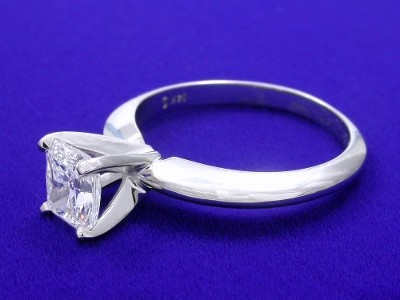 Radiant cut diamond ring with 14-karat white-gold solitaire style mounting with knife-edge shank