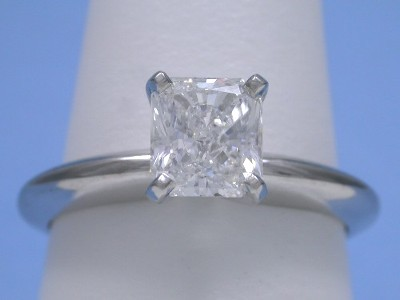 Radiant cut diamond engagement ring with 14-karat white-gold solitaire style mounting