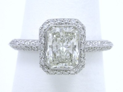 Bezel set radiant cut diamond engagement ring