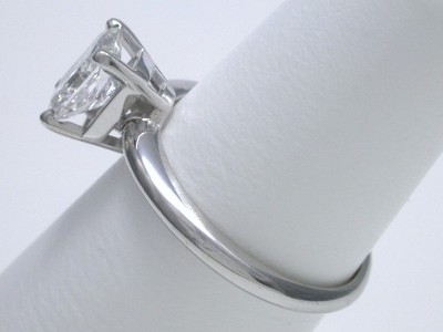 Rectangular Radiant Cut Diamond has 1.31 length-to-width ratio in basket-style head with knife-edge style shank.