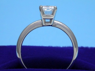 Radiant Cut diamond ring with 14-karat white-gold (Stamped 14K) Solitaire style mounting with a four-prong basket head and knife-edge style shank