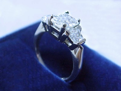 Radiant Cut Diamond Ring: 1.13 carat with 1.33 ratio with 0.60 tcw Trapezoids
