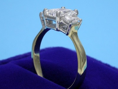Radiant Cut Diamond Ring: 1.15 carat with 1.33 ratio and 0.48 tcw Brilliant Trapezoid Diamonds