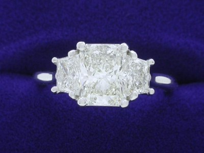 Radiant Cut Diamond Ring: 1.20 carat with 1.30 ratio in 0.59 tcw Trapezoid 3-Stone Mounting