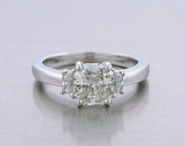 Radiant Cut Diamond Ring: 1.24 carat with 1.04 ratio and 0.21 tcw Trapezoids
