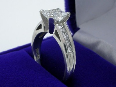 Radiant Cut Diamond Ring: 1.33 carat with 1.07 ratio in 0.50 tcw Princess Diamond Mounting