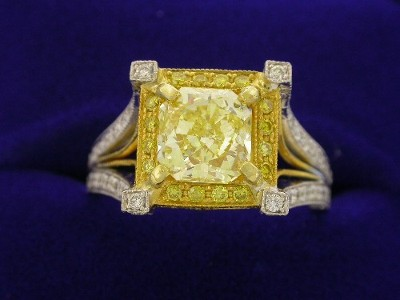 Radiant Cut Diamond Ring: 1.51 carat Fancy Yellow with 1.05 ratio and 1.05 tcw pave mounting