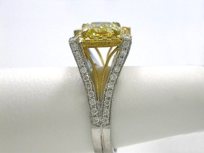 Diamond engagement ring with a cut cornered square modified brilliant (radiant) cut diamond graded Fancy Intense Yellow color, VS1 clarity