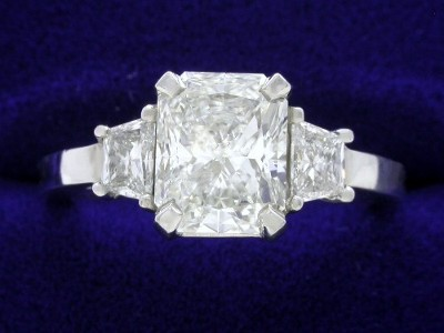 Radiant Cut Diamond Ring: 1.51 carat with 1.23 ratio and 0.33 tcw Trapezoid Side Diamonds