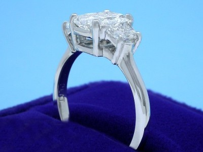 Radiant Cut Diamond Ring: 1.51 carat with 1.36 ratio in 0.67 tcw Trapezoid Three-Stone Mounting