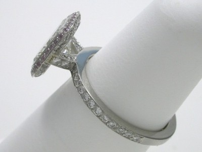 The mounting is a Bez Ambar designer Equinox style, having pave-set round diamonds on bottom of knife edge frame, on three sides of the V-shaped head support and going halfway down the shank