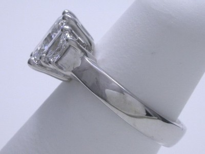 Radiant-cut three-stone diamond engagement ring
