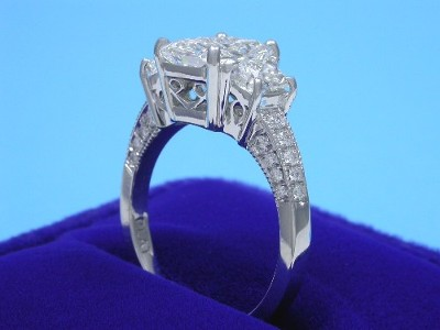 Radiant Cut Diamond Ring: 2.03 carat with 1.28 ratio in 0.84 tcw Trapezoid and Pave Mounting