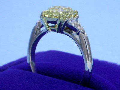 Radiant Cut Diamond Ring: 2.06 carat with 0.40 tcw Trillions