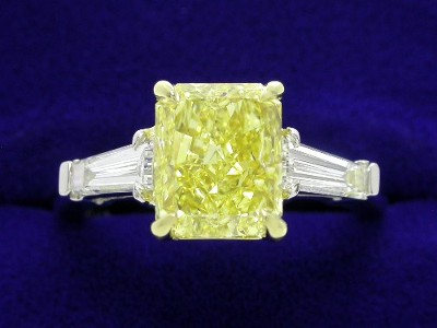 Radiant Cut Diamond Ring: 2.06 carat with 1.23 ratio in 0.49 tcw Tapered Baguette Mounting