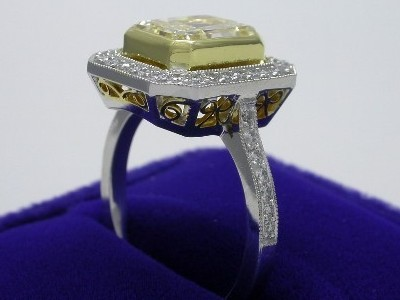 Radiant Cut Diamond Ring: 2.56 carat Fancy Light Yellow in Pave mounting