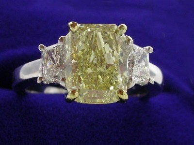 Radiant Cut Diamond Ring: 2.70 carat Fancy Yellow with 0.77 tcw Trapezoids