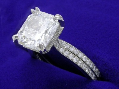 Radiant cut diamond ring with custom platinum Bez Ambar mounting with matching diamond pave wedding band
