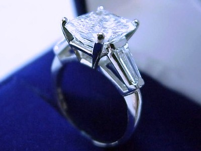 Radiant Cut Diamond Ring: 3.13 carat with 1.22 ratio in Tapered Baguette mounting