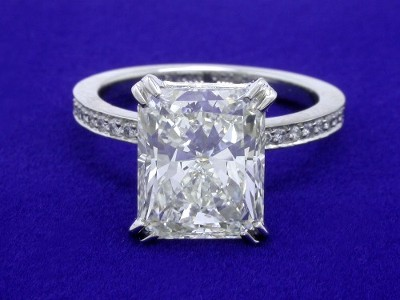Radiant cut diamond prong-set in a split-prong custom Bez Ambar designer platinum pave mounting