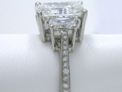 Radiant Cut Diamond Ring: 4.00 carat with 1.30 ratio and 0.83 tcw Brilliant Cut Trapezoid Diamonds
