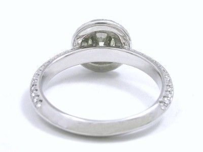 round brilliant cut diamonds French cut pave-set on top of the double-halo and in graduated sizes going three-fourths the way down the double-row knife edge shank