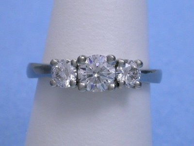 Round Three-Stone Diamond Engagement Ring