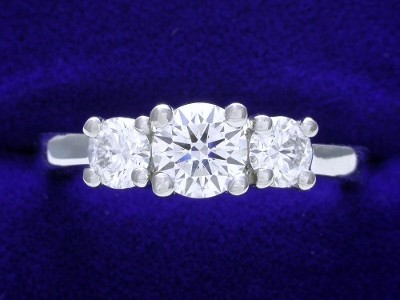 Round Diamond Ring: 0.56 carat with 0.47 tcw Round Diamonds