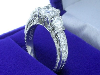 Round Diamond Ring: 0.79 carat in Filigree mounting with 0.40 tcw Round Side Diamonds