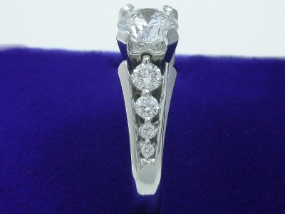 Custom round brilliant cut diamond engagement ring with eight graduated round brilliant diamonds shared prong set in the 14-karat white gold mounting