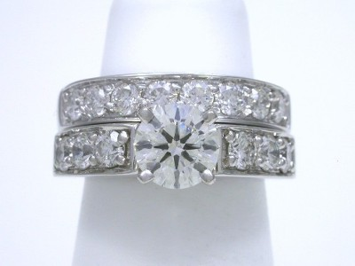 Round brilliant cut diamond engagement ring with shared prong round diamonds and matching diamond band
