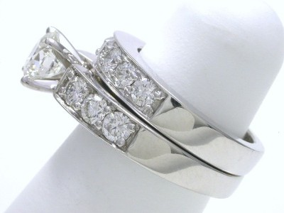 Round diamond engagement ring with matching diamond wedding band