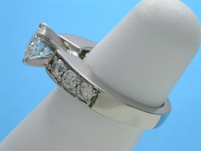 Round brilliant cut diamond engagement ring with shared prong round diamonds