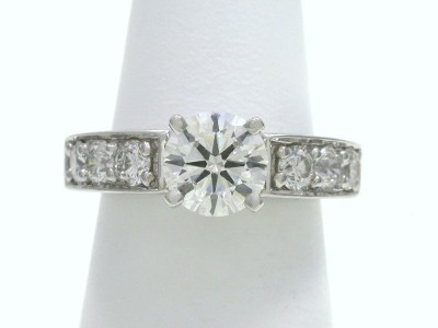 Round Diamond Ring with Shared Prong Round Diamonds