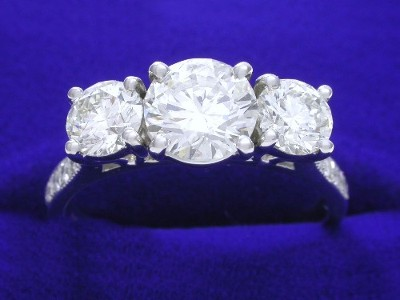 Round Diamond Ring: 1.00 carat with 0.80 tcw Round Sides and 0.14 tcw Pave