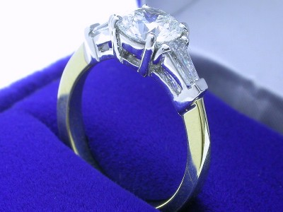 Round Diamond Ring: 1.03 carat with 0.35 tcw Tapered Baguette diamonds